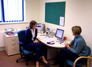 Photograph of a doctor and patient in a consulting room